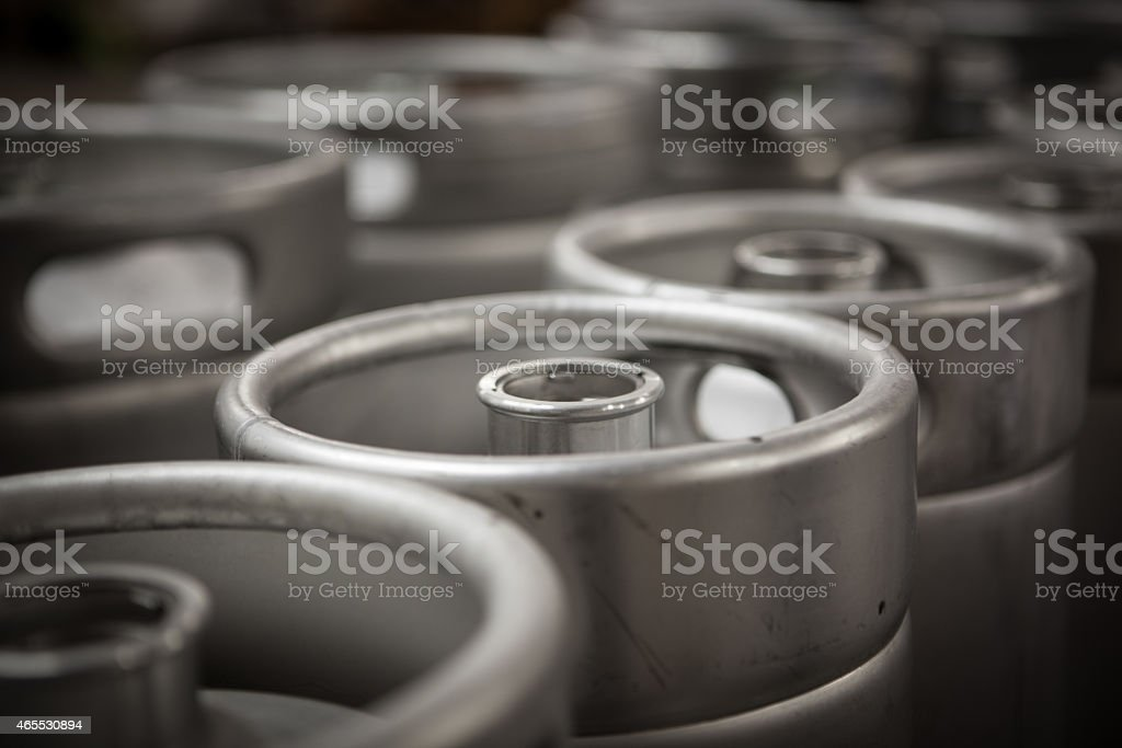 Kegs in a brewery waiting to be filled. stock photo