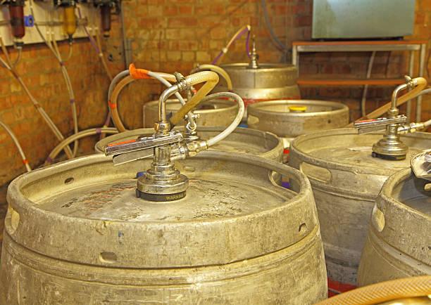 kegs of beer in a cellar stock photo
