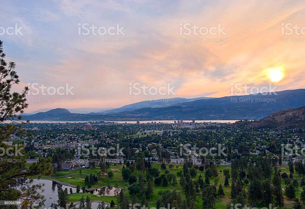 Kelowna sunset, after burn of forest fires stock photo