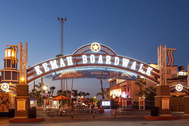 Kemah Boardwalk Entrance at night Kemah, Tx, USA - April 14, 2016: Kemah Boardwalk entrance arch illuminated at night. Texas, United States boardwalk stock pictures, royalty-free photos & images