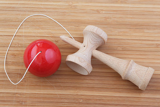Kendama game Traditional Japanese cup and ball game Kendama. Wooden stick with cups and wooden ball on a rope. shell game stock pictures, royalty-free photos & images