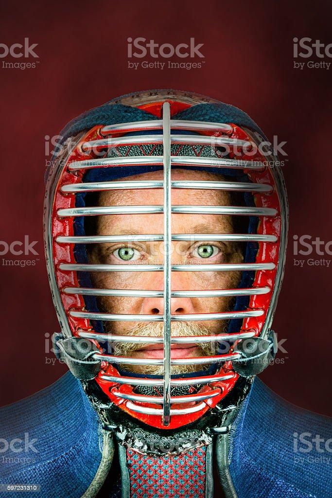 Kendo - Close up portrait of kendoka with helmet. royalty-free stock photo