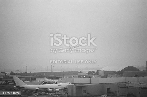 United States - September 14, 2017:  Airplanes taxi and take off at John F Kennedy airport on a hazy morning, Queens, New York, September 14, 2017