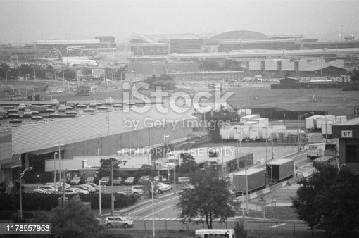 United States - September 14, 2017:  Busy freight terminal and tarmac in the morning at John F Kennedy airport on a hazy morning, Queens, New York, September 14, 2017