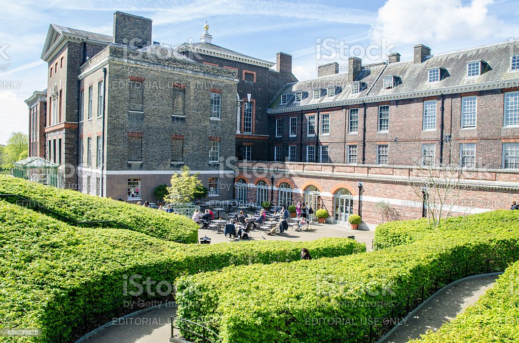 Kensington Palace with people eating outside on the patio royalty-free stock photo