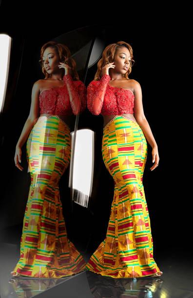 kente reflective fashion - kente cloth stock photos and pictures