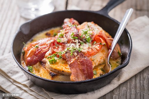 Kentucky hot brown open face sandwich made of Texas toast, turkey, and bacon.  The sandwich is a famous sandwich served in Kentucky with a mint julep and was invented at the Brown Hotel and was served to guest of the Kentucky derby.