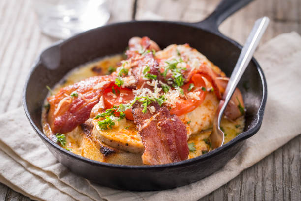 Kentucky Hot Brown Open Face Sandwich Kentucky hot brown open face sandwich made of Texas toast, turkey, and bacon.  The sandwich is a famous sandwich served in Kentucky with a mint julep and was invented at the Brown Hotel and was served to guest of the Kentucky derby. brown stock pictures, royalty-free photos & images