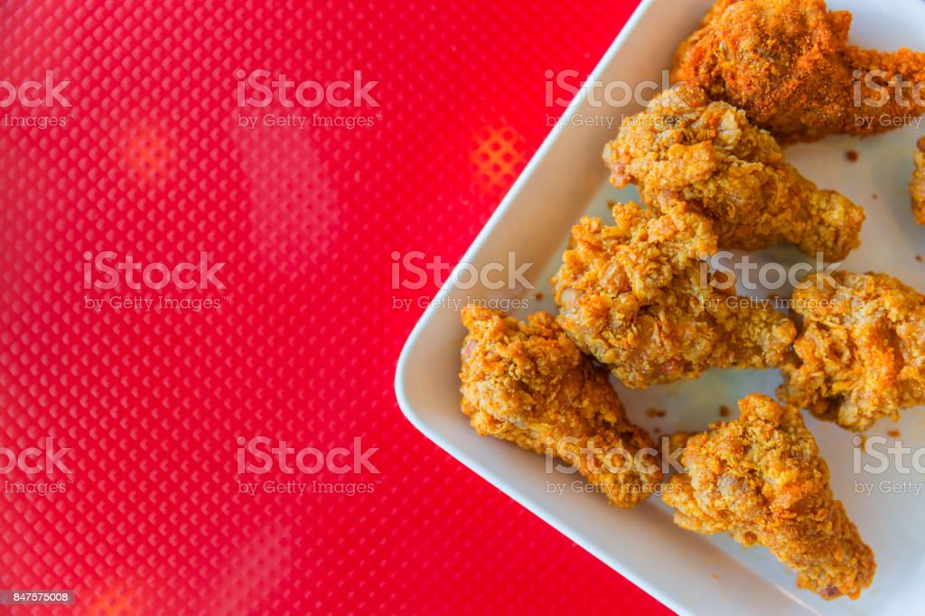 kentucky style fried chicken on red background with space for text stock photo