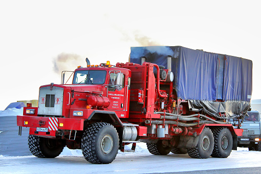 Novyy Urengoy, Russia - February 24, 2013: Red Kenworth T800 truck of the Halliburton oil field service company parked at the city street.