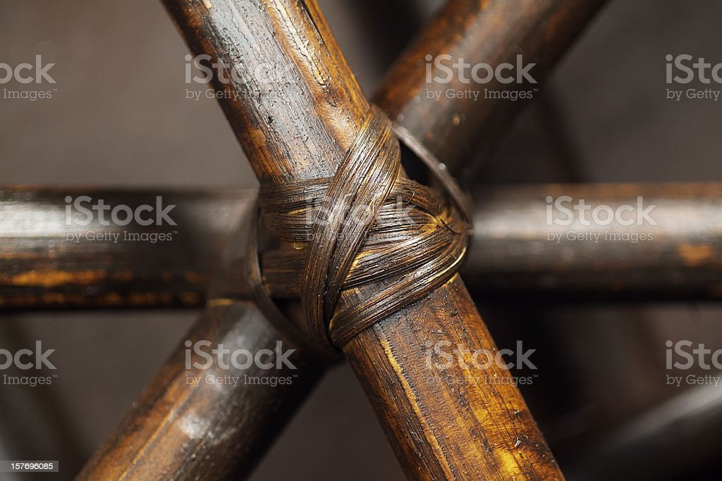 Kept together - Wooden sticks tied with a cord royalty-free stock photo