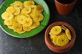 Kerala banana chips popular deep fried snack traditional South Indian tea time snack on banana leaf, Kerala India. made in coconut oil on Onam, Vishu, Diwali/Deepawali, Ramzan, Eid.