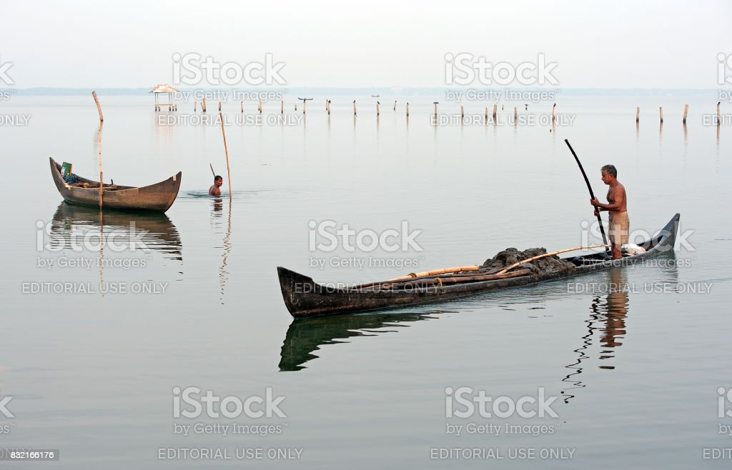 Keralan fishermen, Vembanad Lake, Kumarakom, Southern India. stock photo