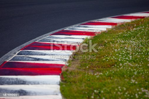 FIA style kerb (curb) on the corner of a motorsports race track.