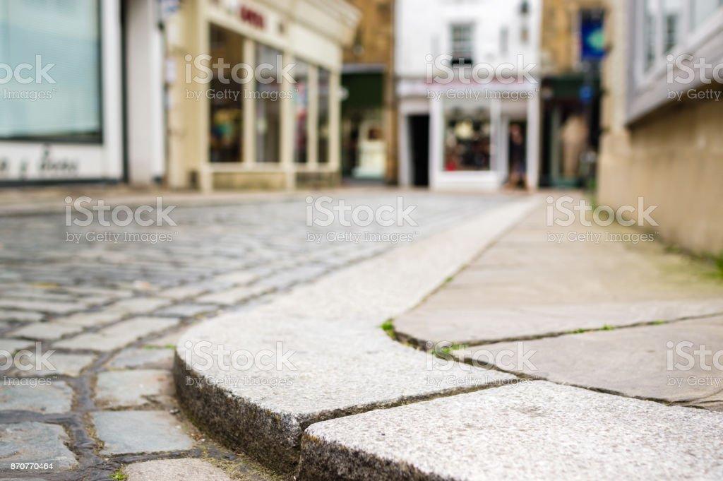 Kerb on cobbled street stock photo