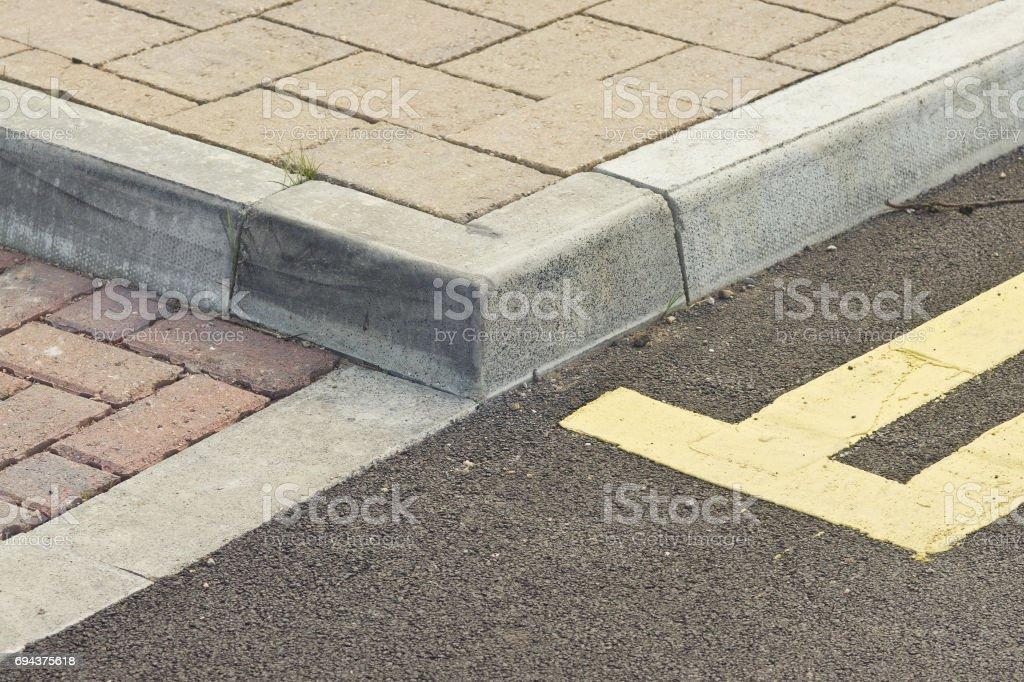 kerb, sidewalk, double yellow line stock photo
