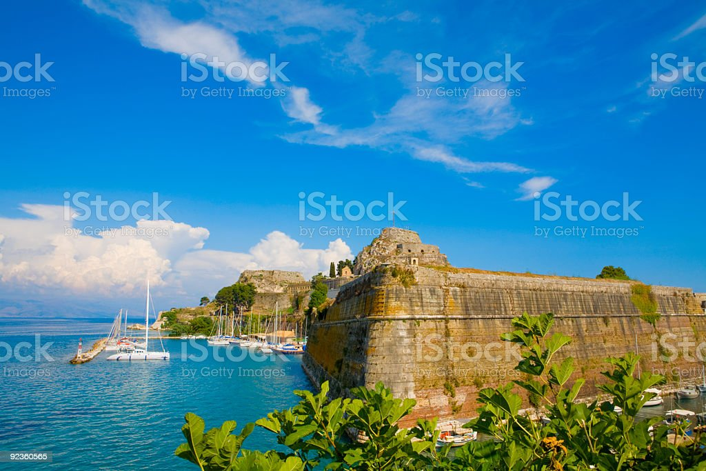 Kerkira fortress and sailboats on a blue sea stock photo