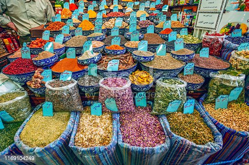 10/05/2019 Kerman, Kerman Province Iran, a huge variety of spices and herbs on a counter on a traditional Iranian eastern bazaar
