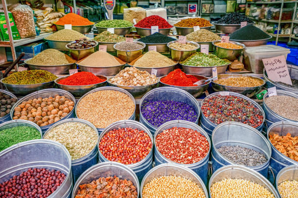 10/05/2019 Kerman, Kerman Province Iran, a huge variety of spices and herbs on a counter on a traditional Iranian eastern bazaar stock photo
