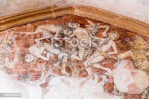Kernascleden, France. Medieval frescoes at the Eglise Notre Dame de Kernascleden, representing death and the purgatory
