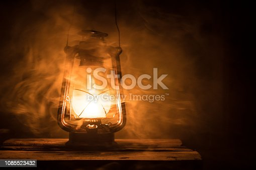 Kerosene lamp with old wooden wall