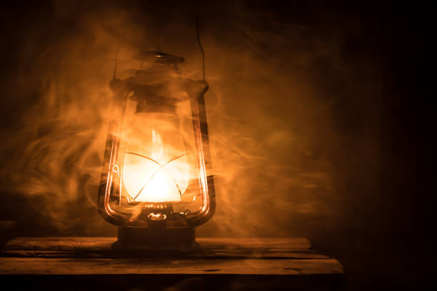 Kerosene lamp with old wooden wall stock photo