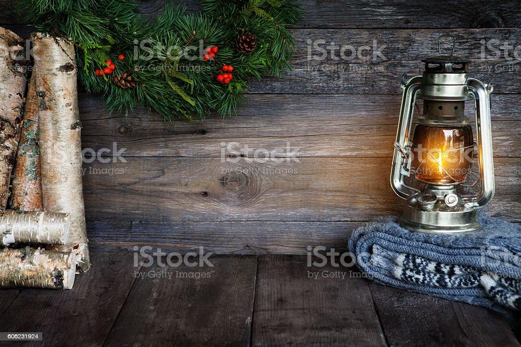 Kerosene lantern and Christmas wreath stock photo