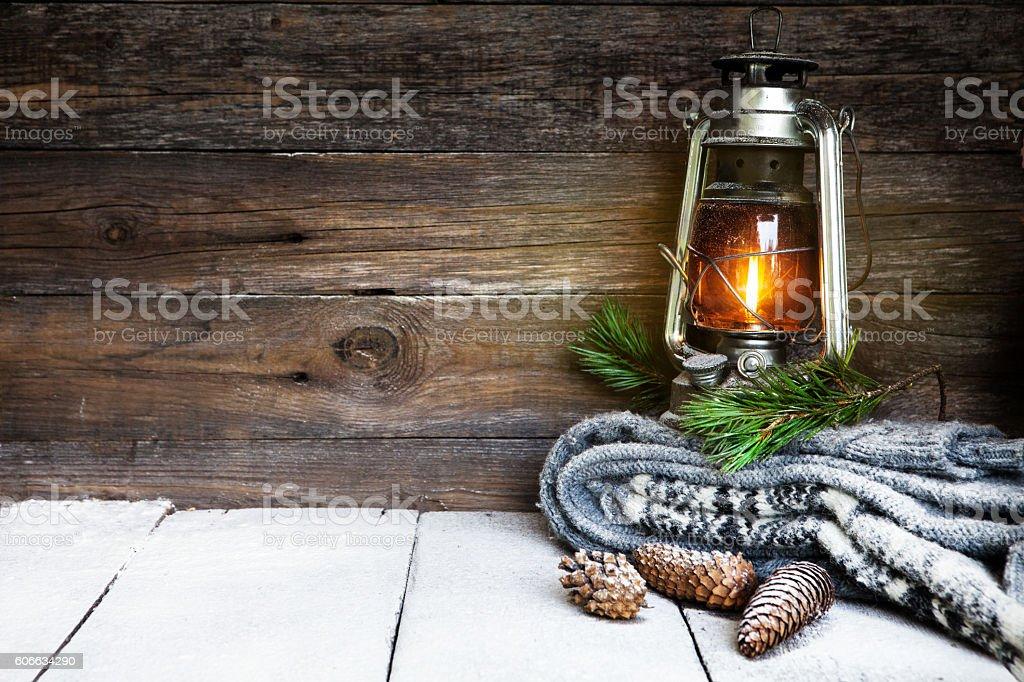 Kerosene lantern and snow stock photo