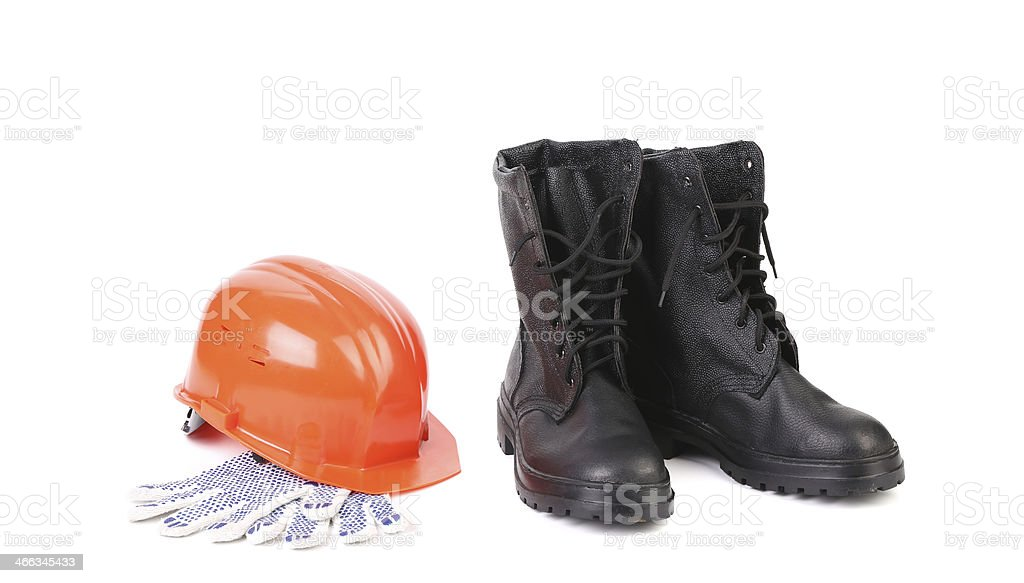 Kersey boots and hard hat on gloves. stock photo