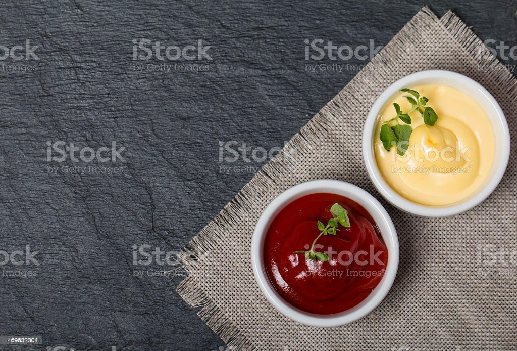 ketchup and mayonnaise - twokinds of sauces stock photo
