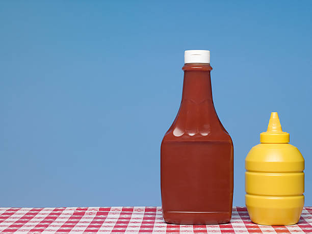 ketchup and mustard - ketchup bottle stock photos and pictures