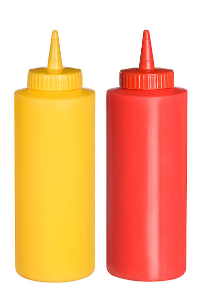 Ketchup and mustard squeeze bottles stock photo