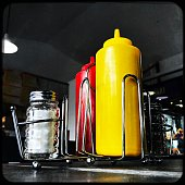 Ketchup and Mustard Squeeze bottles with Salt and Pepper in a Caddy