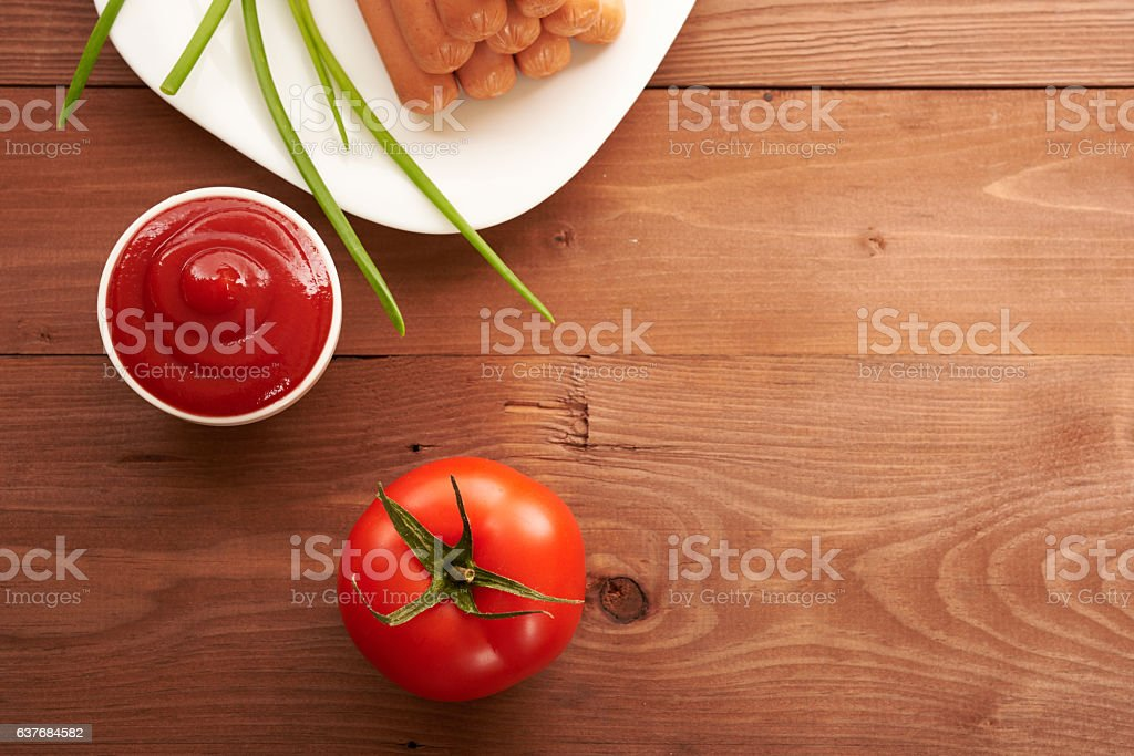 ketchup and tomato on a wooden table stock photo