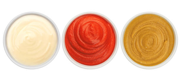 Ketchup, mayonnaise and mustard isolated on white background top view stock photo