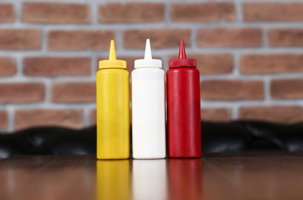 ketchup, mustard and mayonnaise bottles - ketchup bottle stock photos and pictures
