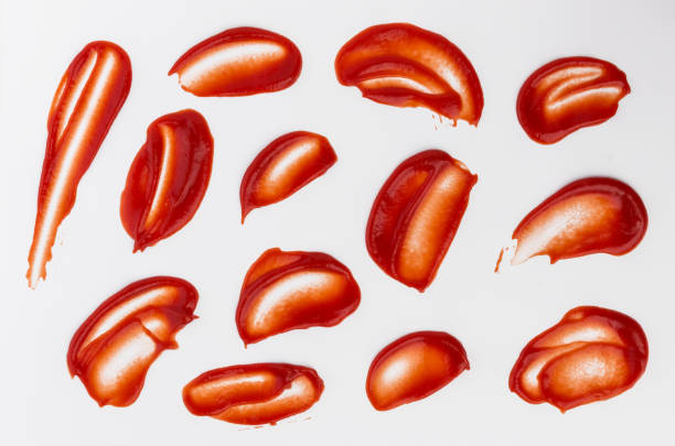 Ketchup stains and splashes isolated on white background Ketchup stains and splashes isolated on white background, top view ketchup stock pictures, royalty-free photos & images