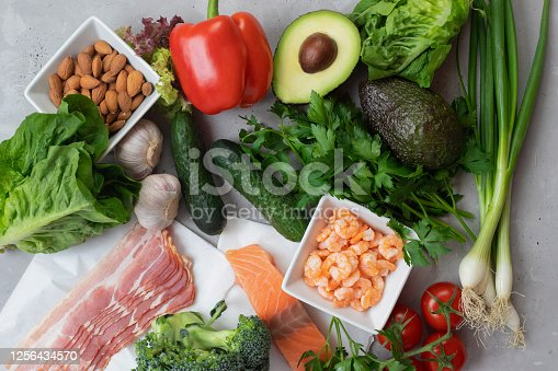 istock Keto diet concept. A set of keto nutrition products. Fresh vegetables, seafood, bacon and nuts. 1256434570