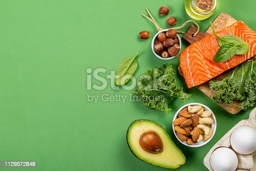istock Keto diet concept - salmon, avocado, eggs, nuts and seeds 1129572848