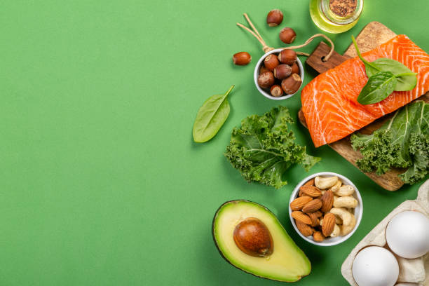 Keto diet concept - salmon, avocado, eggs, nuts and seeds