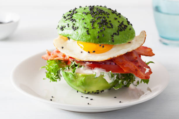 keto paleo diet avocado breakfast burger with bacon, egg, tomato keto paleo diet avocado breakfast burger with bacon, egg, tomato ketogenic diet stock pictures, royalty-free photos & images