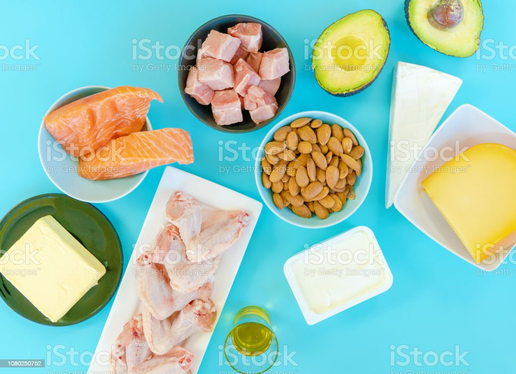 Ketogenic diet food. Low-carb food background, fish, meat, cheese, nuts, oil and butter on a blue background. mockup,  flatlay, flat lay Top view Keto diet concept. royalty-free stock photo