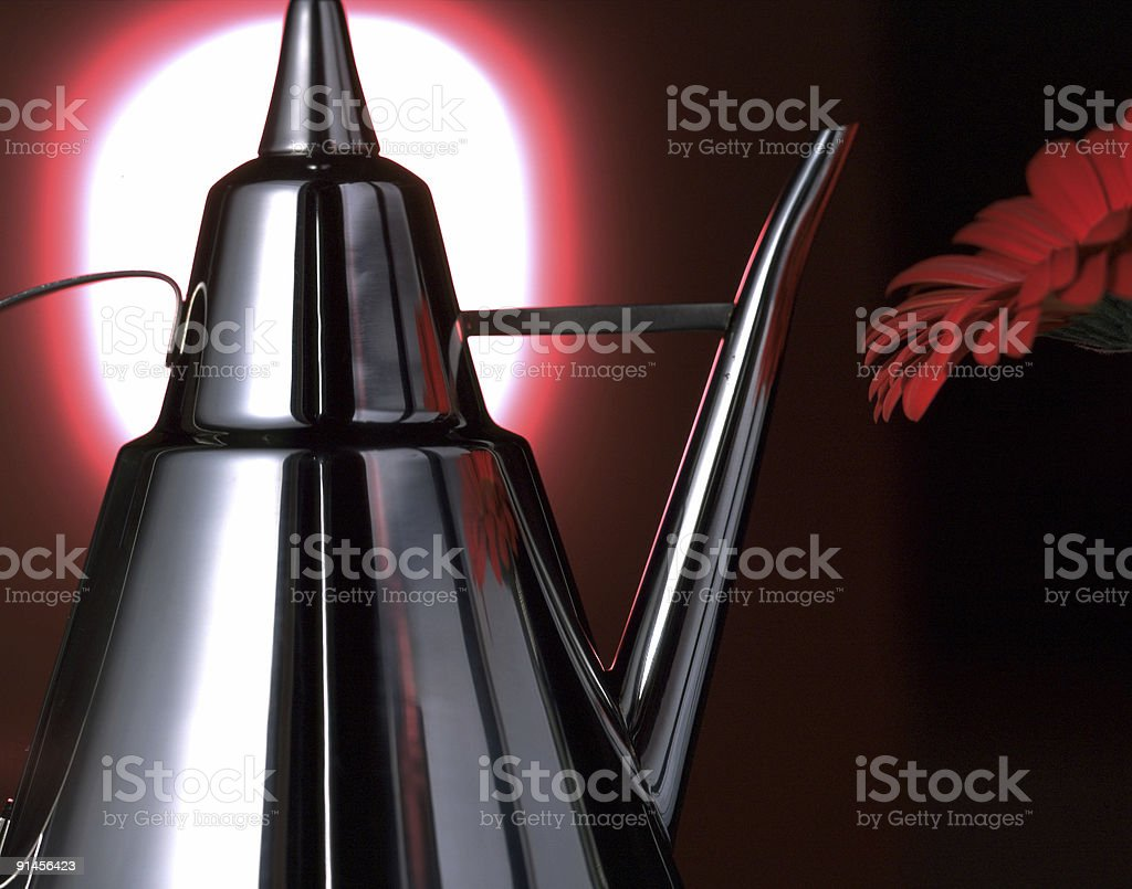 Kettle and flower royalty-free stock photo