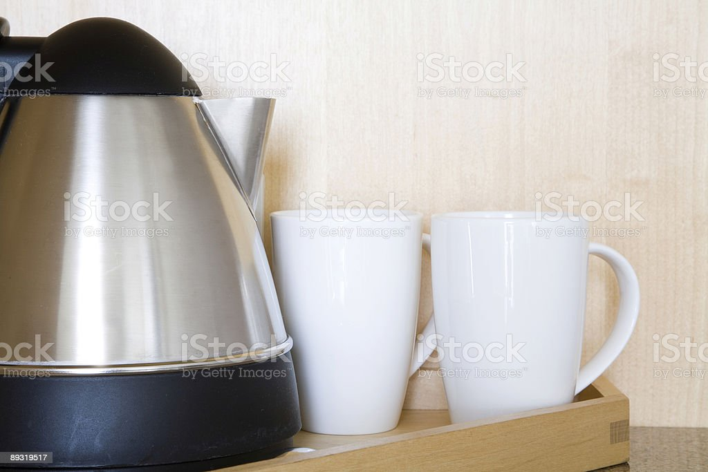 Kettle and mugs stock photo