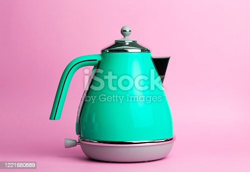 Kettle Background. Electric vintage retro kettle on a colored pink background. Lifestyle and design concept.