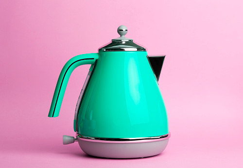 istock Kettle Background. Electric vintage retro kettle on a colored pink background. Lifestyle and design concept 1221680889