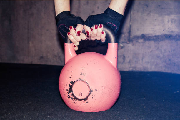 Kettle Bell Held by Woman stock photo