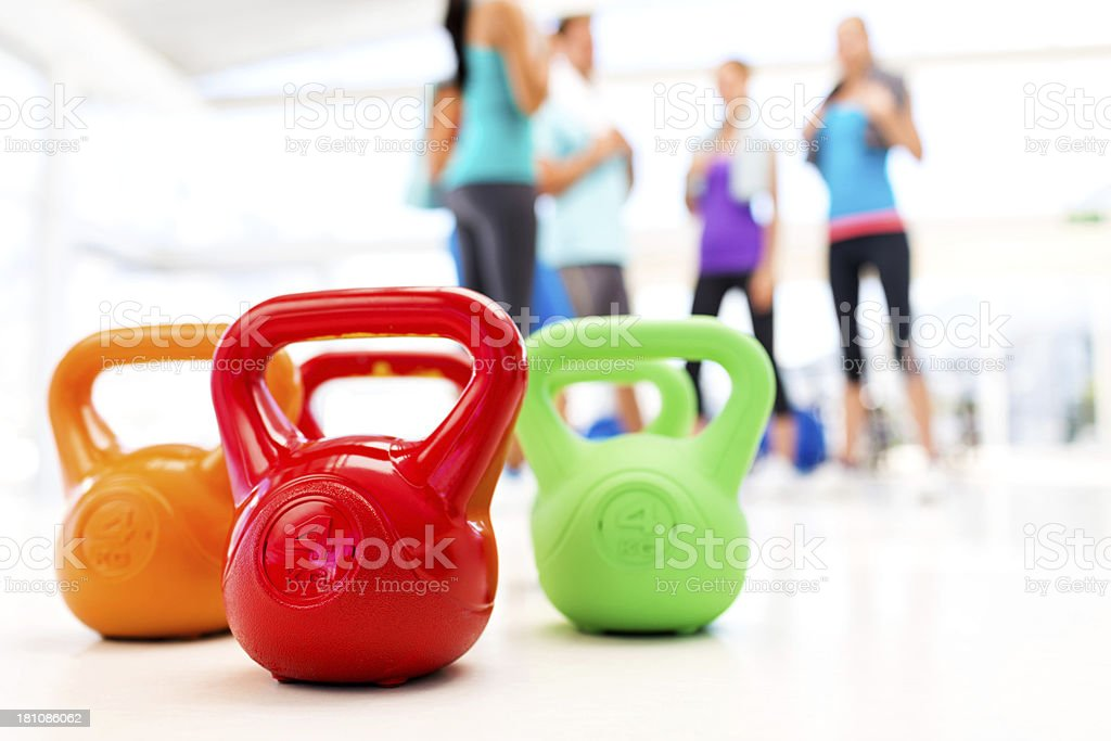 Kettle Bells With People In Background At Gym royalty-free stock photo