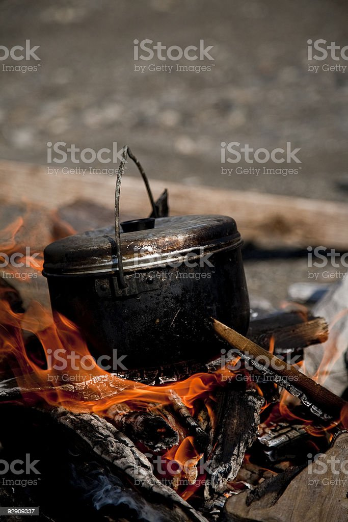 Kettle on a fire royalty-free stock photo