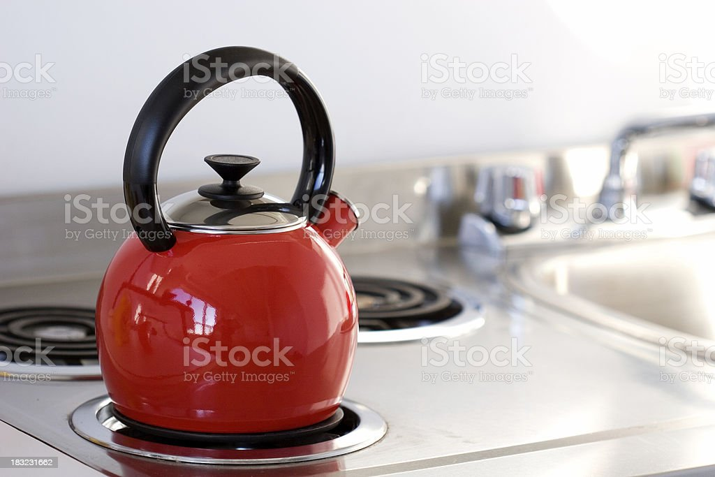 Kettle on Stovetop stock photo